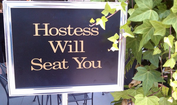 Hostess will seat you sign: patience